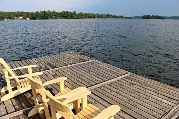 Muskoka chairs overlooking Stoney Lake at Viamede Resort