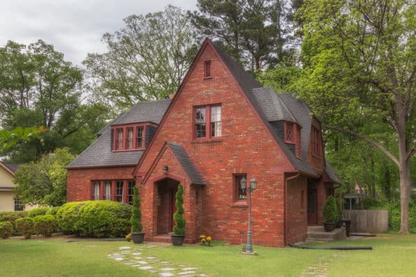 black color shingle roof creates the best quintessential timeless exterior for your red brick house