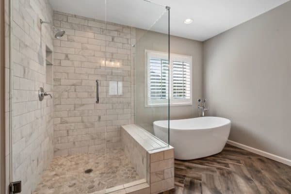 Large custom shower, and free standing tub.