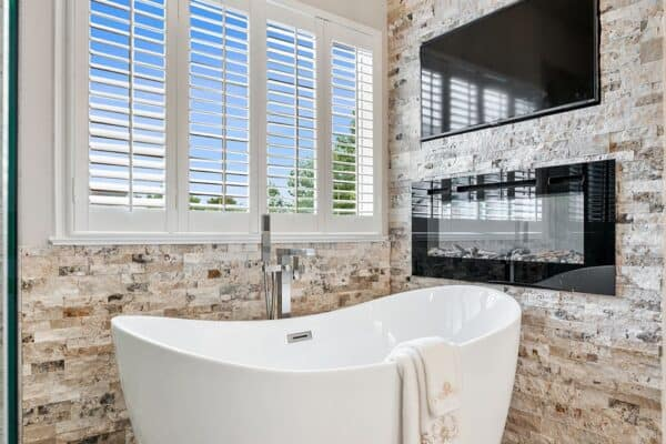 Watch your favorite show while relaxing in this freestanding tub.