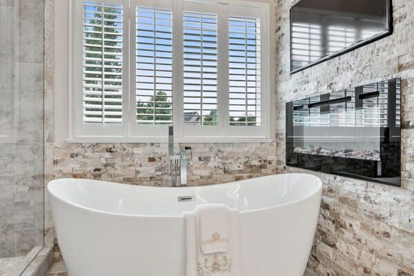 Modern freestanding tub and faucet are spectacular in this master bath remodel.