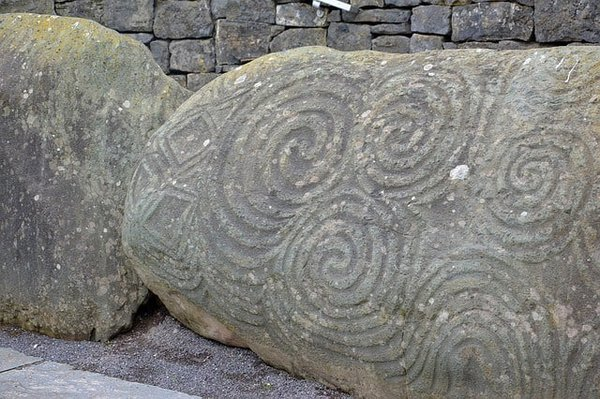 Celtic scrollwork on the rocks at newgrangeceltic scrollwork at newgrange