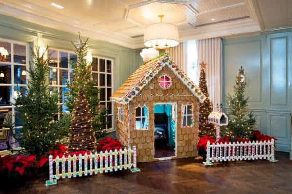 The woodstock inn builds a kid-size gingerbread cottage in its lobby and surrounds it with locally grown trees at christmas time.