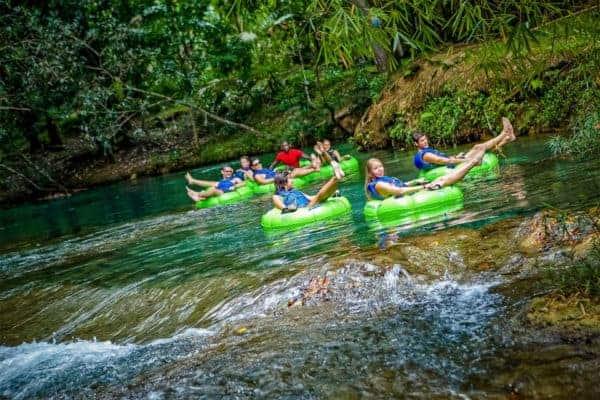 Tubing down a river in negril jamaica, the type of activity you might try on a honeymoon with kids.
