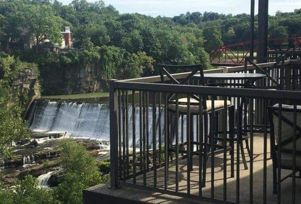 The Esopus Creek Falls and Saugerties Bridge as seen from a room's balcony at the Diamond Mills Hotel.