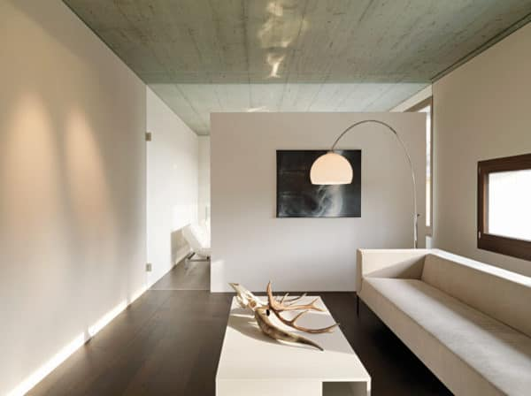 simple white half wall to divide the room in a modern and minimalist home