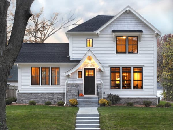 two-story wood exterior white house equipped with metal black windows