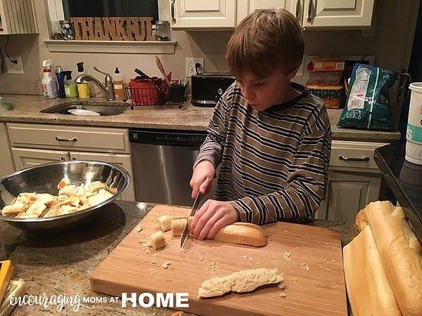 Caleb Slicing Bread for Fondue