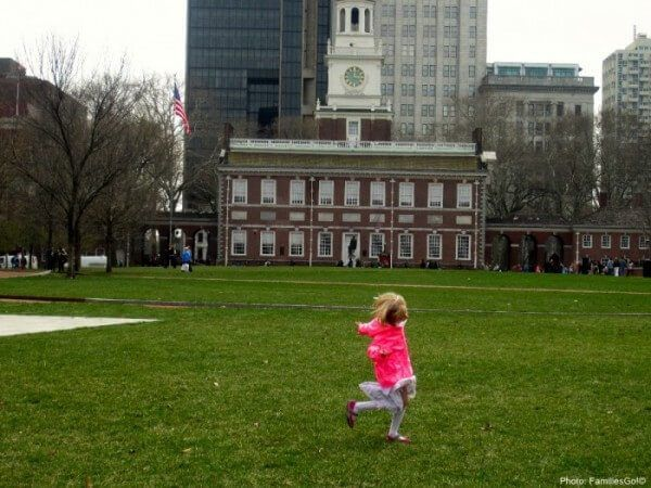 Running on the lawn by independence hall in philadelphia
