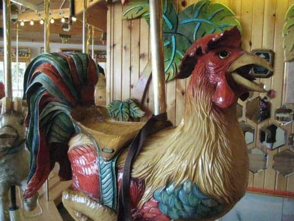 Ride this colorful rooster on the carousel at lark toys in wisconsin.
