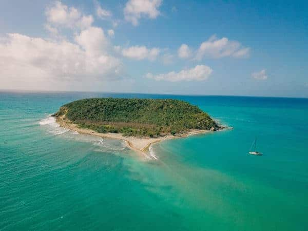 The island of vieques, puerto rico, from the air, surrounded by the clear blue and green caribbean sea for snorkeling.