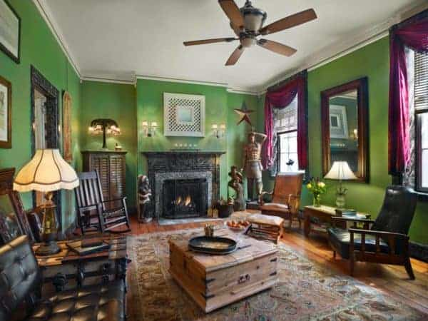 The common rooms at Olivia's Bridge Street Inn are 19th centure smart. This one has bright green walls, leather chairs and a working fireplace.