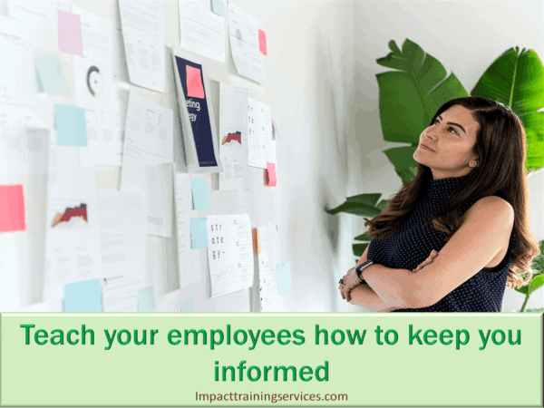 image showing female owner showing employees how to keep her informed and reduce employee turnover