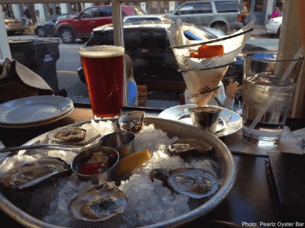 Oysters, beer and corn fritters at pearlz