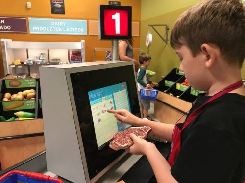 Buying groceries at kidtropolis a the houston childrens museum