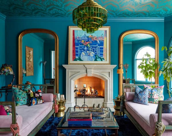 get a funky and colorful vibe in this moroccan-inspired living room with blue walls and gold arches