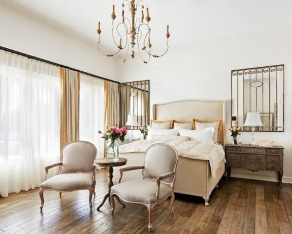 get the elegant look with white sheets and gold chandelier for your bedroom