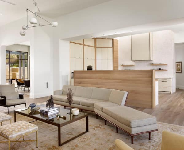 half wall white oak kitchen divider for a clean, bright, and contemporary room
