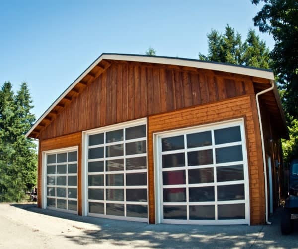 use windows in your garage doors with white trimming while embracing the classic barn style