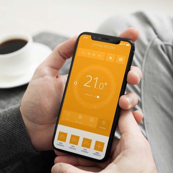 Rointe Connect Lite app on smartphone controlling temperature of Belize radiators