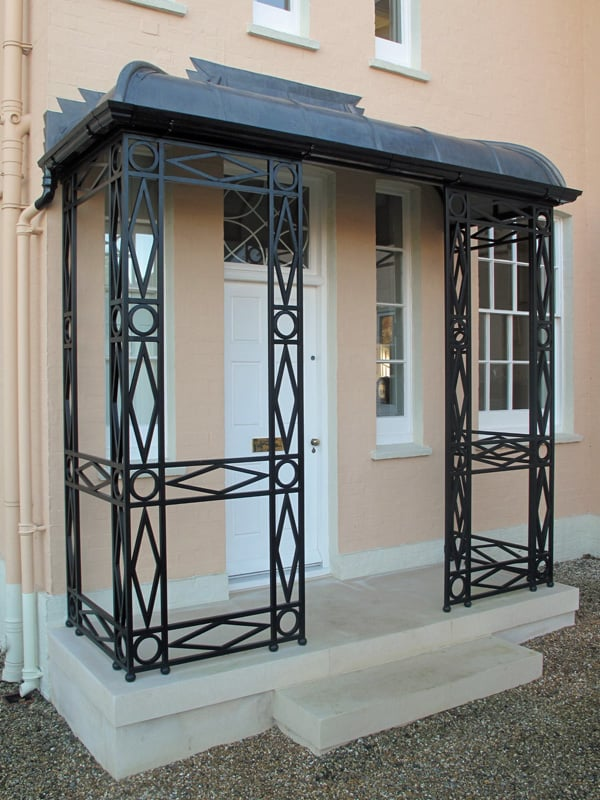 bold decorative wrought iron columns for a clean porch