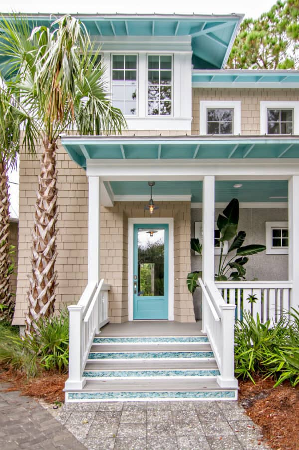 reflecting pool front door in a beige house to evoke tropical beach style