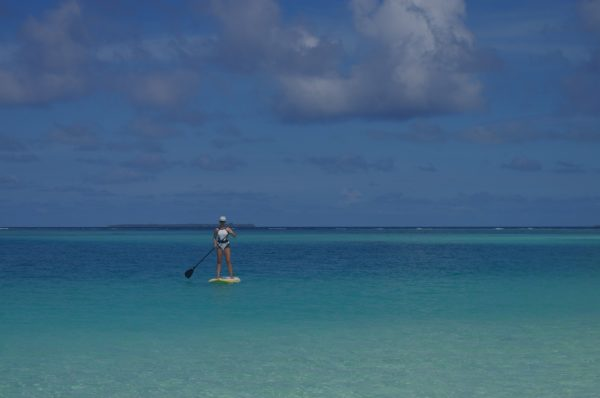 Stand Up Paddleboarding on a Maldives family holiday while exploring Maldives with kids