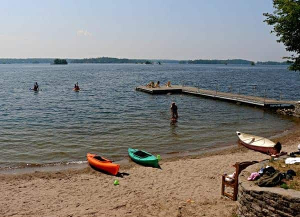 View of the beach and dock on Stoney Lake at Viamede Resort