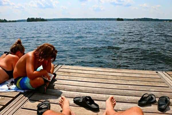 Reading on the dock on Stoney Lake at Viamede Resort