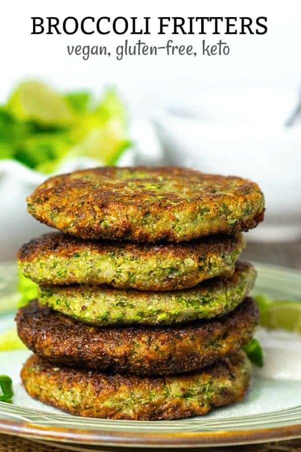Broccoli fritters stacked, 5 of them with salad in the background