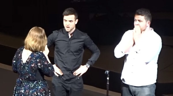 Adele live on stage with two Irish guys