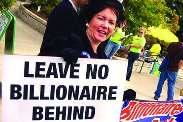 "Woman with sign reading ""LEAVE NO BILLIONAIRE BEHIND"""