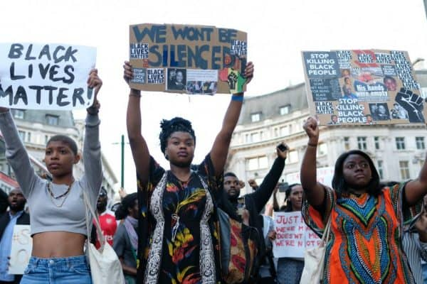 3 Women protesting police brutality
