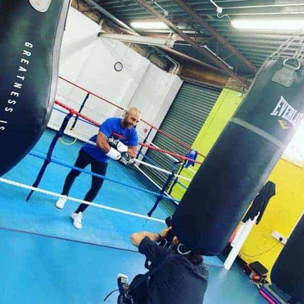 Empire Fighting Chance ambassador, ITV's Alex Beresford stood in the ring