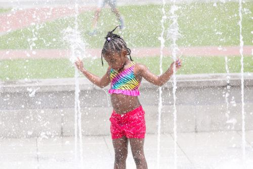 Kids love to cool off in the fountains on savannah's  ellis square.