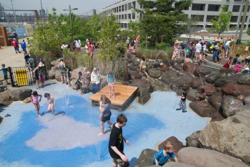 Kids, parents and grandparents all get wet in the waterplay area at brooklyn's pier 6.
