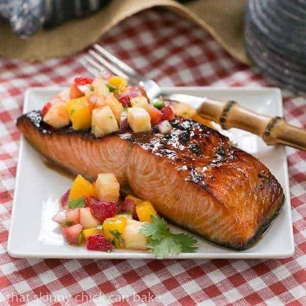 Maple Glazed Salmon on a square white plate topped with fruit salsa