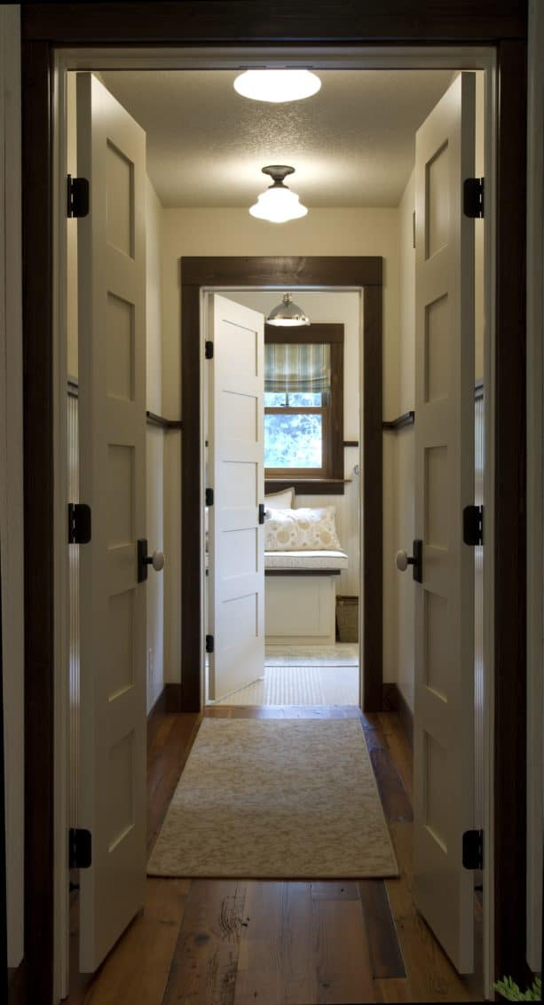 white doors and dark stained wood trim in an elegant hallway