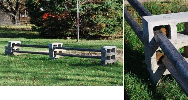 an example of way to arrange cinder block and wood to create a fence