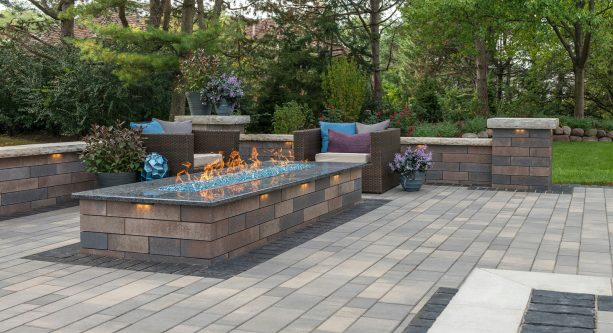 a simple and minimalist design patio with concrete paver and rectangular fire pit