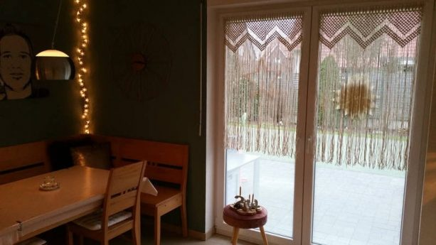 white macramé curtains as glass door covering