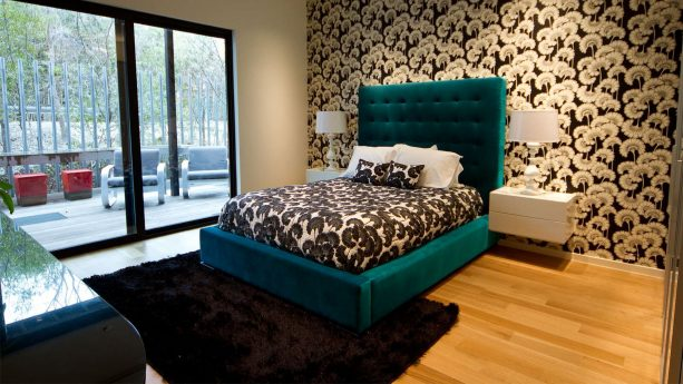 a modern teal bedroom paired with black area rug