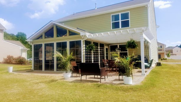 pergola attached to a roof of a craftsman screened-in back porch