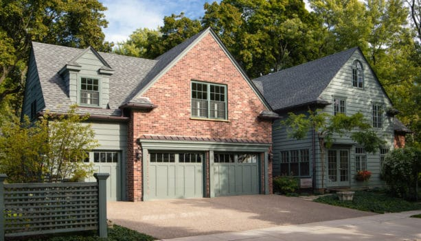 sage green siding and red brick combination for creating a timeless exterior