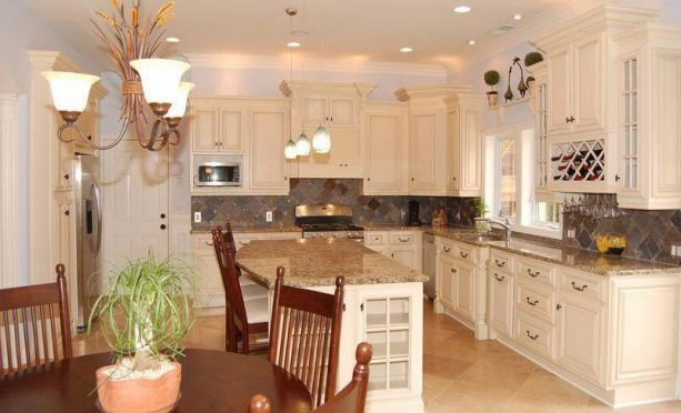 kitchen with traditional antique white cabinets