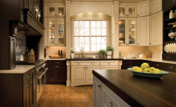 cream kitchen cabinets with dark wood countertops
