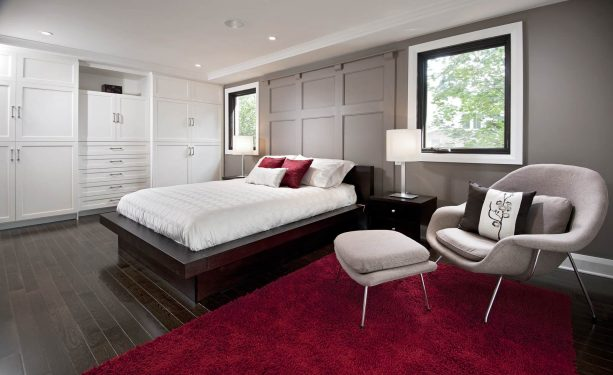 grey bedroom with fluffy red rug