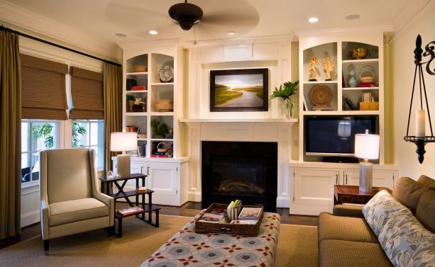 a stone standard fireplace with built-in shelves around as a media wall