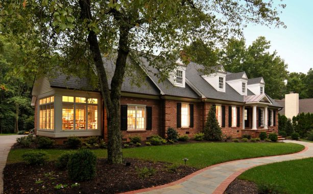 classic brick house exterior with shutters only for decoration