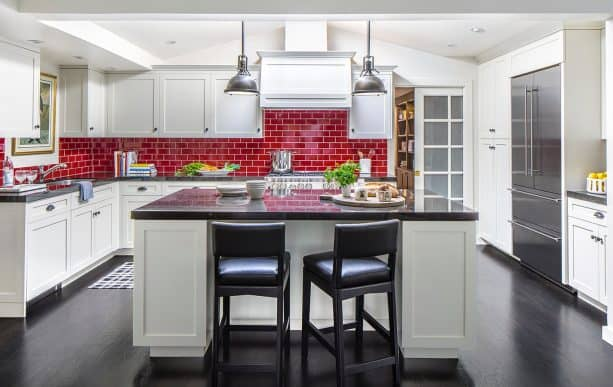 another view of the kitchen showing how stunning the red subway tile backsplash looks
